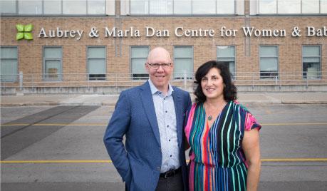 Aubrey and Marla standing in front of Aubrey & Marla Dan Centre for Women & Babies